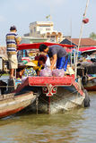 Fresh produce vendors sell from boat to boat Royalty Free Stock Images