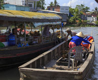 Fresh produce vendors sell from boat to boat at the Cai Rang flo Royalty Free Stock Images