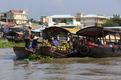 Fresh produce vendors sell from boat to boat at the Cai Rang floating market Royalty Free Stock Image