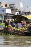 Fresh produce vendors sell from boat to boat at the Cai Rang floating market Royalty Free Stock Photos