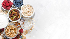 Fresh products for a healthy breakfast on white table, top view. Horizontal Royalty Free Stock Photo