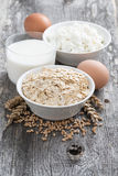 Fresh products - oatmeal, eggs, cottage cheese and milk Stock Photo