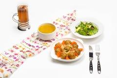 Fresh pumpkin cream soup and salad Stock Photos