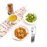 Fresh pumpkin cream soup and salad Stock Photography
