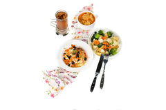 Fresh pumpkin cream soup and salad Royalty Free Stock Photo