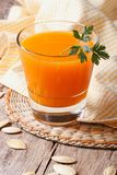 Fresh pumpkin juice in glass close up. Vertical Royalty Free Stock Images