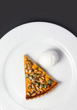 Fresh Pumpkin Pie with whipped cream and pumpkin seeds on white Stock Photos