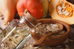 Fresh pumpkin seed oil in a bottle macro on the table. Horizonta Stock Images