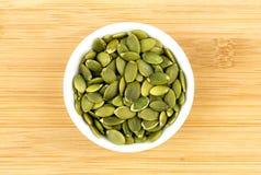 Fresh pumpkin seeds in bowl Stock Photos