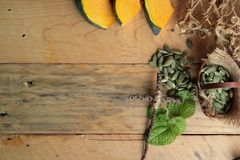 Fresh pumpkin slice with pumpkin seeds dry. Royalty Free Stock Photo