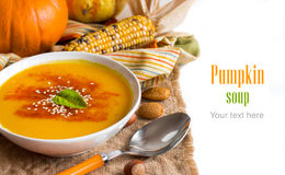 Fresh pumpkin soup with a spoon and vegetables Royalty Free Stock Photo