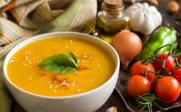 Fresh pumpkin soup with a spoon and vegetables Royalty Free Stock Photography