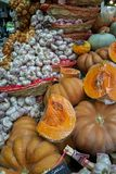 Fresh pumpkins and garlic for sale in the marketplace stock photos