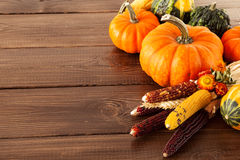 Fresh pumpkins on a wooden table Stock Images