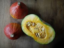 Fresh pumpkins on a wooden table stock image