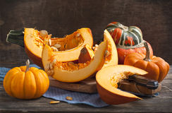 Fresh pumpkins on wooden table Royalty Free Stock Image