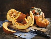 Fresh pumpkins on wooden table Stock Photos