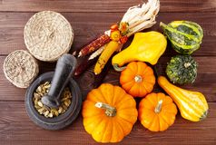 Fresh pumpkins on a wooden table Royalty Free Stock Image