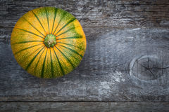 Fresh pumpkins on wooden table Stock Photos