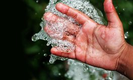 Fresh pure bubbling water splashing on hand Royalty Free Stock Image