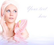 Fresh purity. Young girl with pink flower Royalty Free Stock Photo