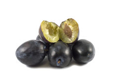 Fresh purple plums  against white. Close-up of fresh purple plums  against white Royalty Free Stock Photography