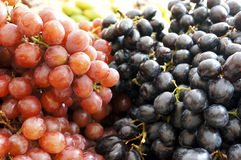 Fresh Purple and Red Grape. On the market Royalty Free Stock Photography