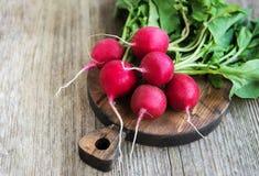 Fresh purple redish. Fresh purple radish on a old wooden table Stock Image