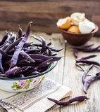 Fresh purple string beans on a gray wooden table,clean eating Stock Photography