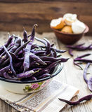 Fresh purple string beans on a gray wooden table,clean eating Royalty Free Stock Photos