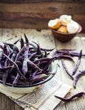 Fresh purple string beans on a gray wooden table,clean eating Royalty Free Stock Photo