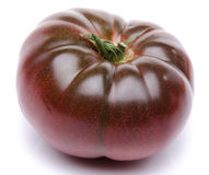 Fresh purple tomato. On white Royalty Free Stock Photo