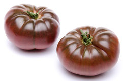 Fresh purple tomatoes. On white Stock Photo