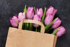 Fresh purple tulip flowers bag Royalty Free Stock Image