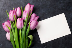 Fresh purple tulip flowers and greeting card Royalty Free Stock Image