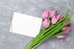 Fresh purple tulip flowers and greeting card Royalty Free Stock Photography