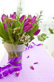 Fresh purple tulips. Bouquet of Fresh purple tulips and blooming branches Stock Photo