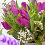Fresh purple tulips. Bouquet of Fresh purple tulips and blooming branches Royalty Free Stock Photos