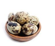 Fresh quail eggs in a bowl. Group of fresh, tasty quail eggs in an earthenware bowl , isolated on white background Royalty Free Stock Photo