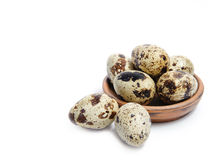 Fresh quail eggs in a bowl. Group of fresh, tasty quail eggs in an earthenware bowl , isolated on white background Royalty Free Stock Photos