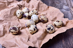 Fresh quail eggs on brown paper Royalty Free Stock Photos