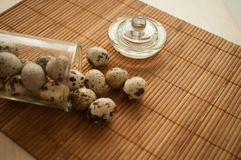 Fresh quail eggs. Quail eggs in a decorative glass jar on the table Stock Photography