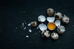 Fresh quail eggs food background. Fresh Quail eggs on dark moody background Stock Photo