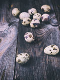 Fresh quail eggs on a gray wooden surface Stock Photography