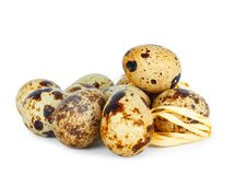 Fresh quail eggs on isolated background stock photography