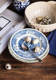 Fresh quail eggs on a plate. Selective focus Stock Image