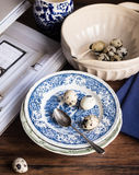 Fresh quail eggs on a plate. Selective focus Royalty Free Stock Images