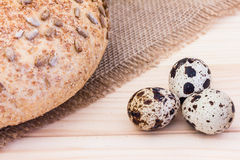 Fresh quail eggs with rye bread. On sackcloth Stock Images