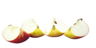 Fresh quarters apple on white Royalty Free Stock Photo