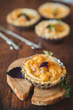 Fresh Quiche lorraine. Close-up of Quiche lorraine with fresh basil on the old wooden board Stock Photos